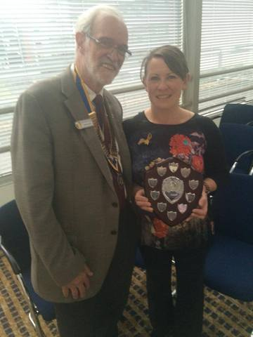 Sarah collecting the award for most funds raised