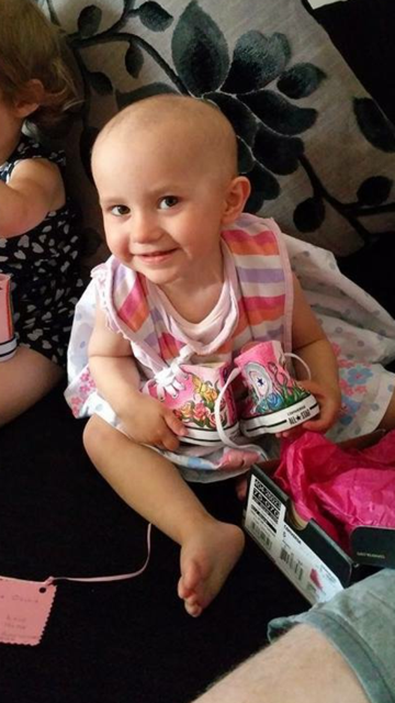 Brain tumour fighter Super Oliva with her Supershoes in 2015